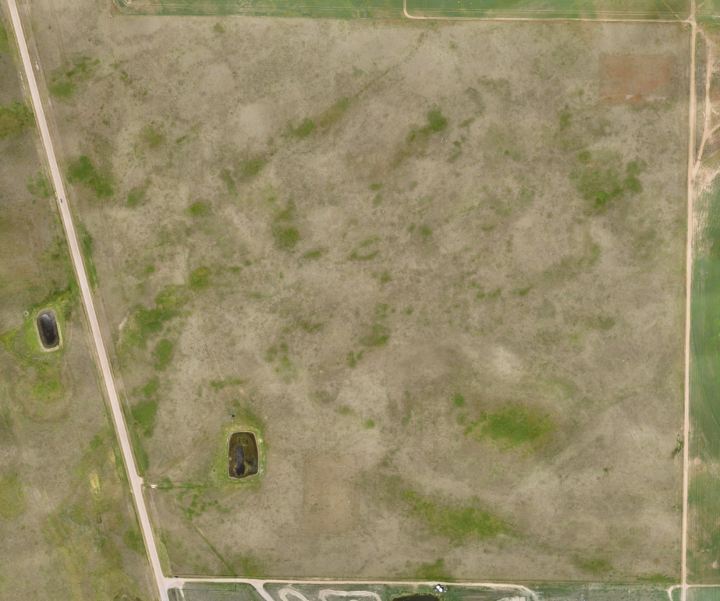 The eBee orthomosaic from the project's preliminary survey, showing the ground before any construction occurred.