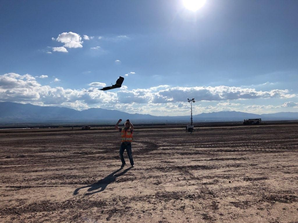 Ames Construction surveyor catching senseFly's eBee X after a successful data capture.