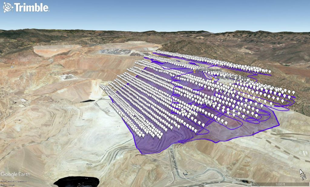 Open-pit mine wall with an overlay showing the image capture area flown by the senseFly eBee X fixed-wing drone.